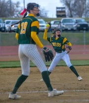 CMR's Lauren Lindseth throws to first base as pitcher Madi Moore (19) watches during the last year's crosstown softball game against Great Falls High. Fears of the COVID-19 virus has shelved all spring sports in Montana for the time being.