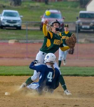 CMR second baseman Teagan Taylor attempts a to turn a double play as Great Falls High's Skylar Anthony slides into second base.