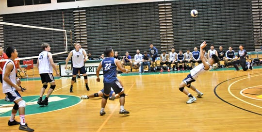 Harvest middle blocker JR Noh goes matrix to pass a ball in IIAAG Boys Volleyball action May 2 at the UOG Calvo Field House.