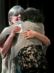 Holocaust survivor Esther Davidson, left, hugs her daughter Sharie Fay Fields after they both spoke during the City of Carmel's ceremony remembering the victims of the Holocaust, held at the Tarkington Theater at the Center for the Performing Arts, Friday, May 3, 2019.