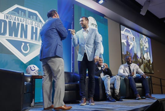 Indianapolis Colts quarterback Andrew Luck greets Jeff Saturday during the Colts Town Hall Meeting with their fans and season ticket holders at the Colts Complex Thursday, May 2, 2019.