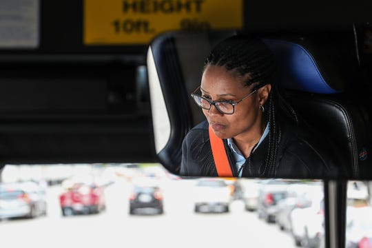 """Misti El-Shabazz drives an afternoon IndyGo route in Indianapolis, Tuesday, April 30, 2019. El-Shabazz, who has driven for IndyGo since 2014, recently won a Visit Indy ROSE Award for service excellence. """"I just have the heart to share and care for these people,"""" El-Shabazz said of her passengers."""