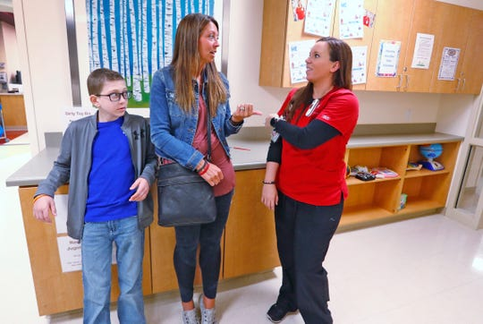 Cameron Kirk, from left, listens as his mother Carrie Kirk talks with his nurse, Rhea Watson at the Center for Pediatric Cancer and Blood Disorders at the Riley Outpatient Center, Friday, April 19, 2019.  Watson was treated for leukemia when she was younger, diagnosed ten years ago, and now is an RN taking care of similar patients, like Cameron who has diagnosed with the same cancer one year ago.  Now Watson is hoping to be the Leukemia & Lymphoma Society Woman of the Year, in a fundraising effort which ends May 18, 2019.