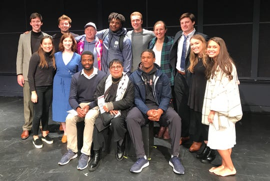 Notre Dame professor Anton Juan (front center), flanked by track sprinter Edward Cheatham (L) and football lineman Julian Okwara (R), poses with students from his acting for non-majors class