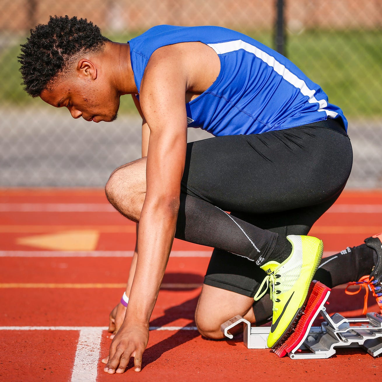 FILE – Hamilton Southeastern sprinter Noah Malone waits for the gun to sound during the 200-meter dash prelims in the boys sectional track and field meet at Carmel High School on May 18, 2017.