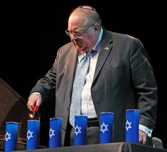 Rabbi Benjamin Sendrow, from the Congregation Shaarey Tefilla, lights candles in remembrance of those who died during the Holocaust, during the City of Carmel's ceremony remembering the victims of the Holocaust, held at the Tarkington Theater at the Center for the Performing Arts, Friday, May 3, 2019.  Six candles were lit to remember the six million Jewish people who died during the Holocaust.  The ceremony is being held in conjunction with the National Days of Remembrance.