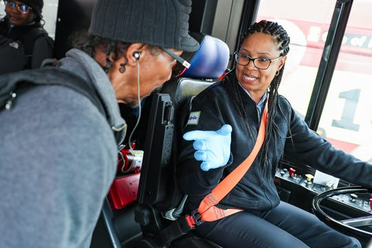 "Misti ""Honey Bun"" El-Shabazz, an IndyGo driver since 2014, greets a passenger in Indianapolis on Tuesday, April 30, 2019. El-Shabazz recently won a Visit Indy ROSE Award for service excellence. She regularly shares her favorite sweet treat, honey buns, with a passenger who is homeless and often hungry, earning her the nickname."