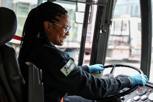 """Misti El-Shabazz greets a passenger who boards the bus along her IndyGo route in Indianapolis, Tuesday, April 30, 2019. El-Shabazz, who has driven for IndyGo since 2014, recently won a Visit Indy ROSE Award for service excellence. """"I just have the heart to share and care for these people,"""" El-Shabazz said of her passengers."""