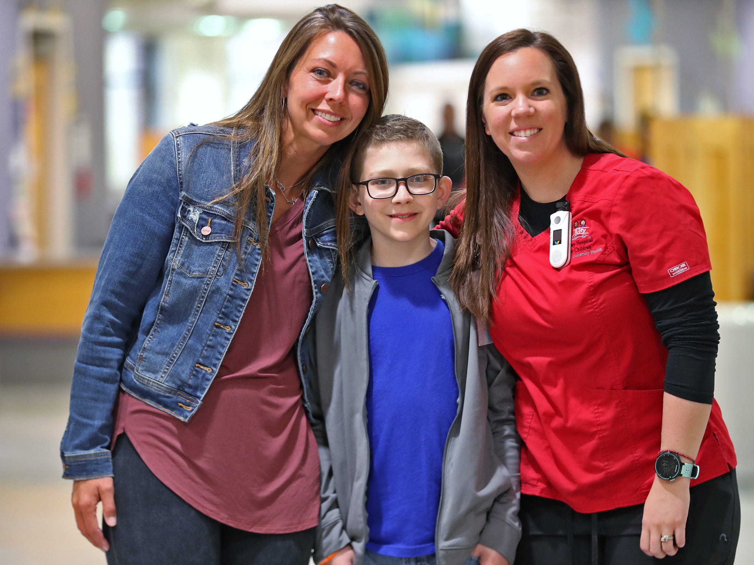 Cameron Kirk, center, poses with his mother Carrie Kirk, left, and his nurse and family friend Rhea Watson at the Center for Pediatric Cancer and Blood Disorders at the Riley Outpatient Center, Friday, April 19, 2019.  Watson was treated for leukemia when she was younger, diagnosed ten years ago, and now is an RN taking care of similar patients, like Cameron who has diagnosed with the same cancer one year ago.  Now Watson is hoping to be the Leukemia & Lymphoma Society Woman of the Year, in a fundraising effort which ends May 18, 2019.