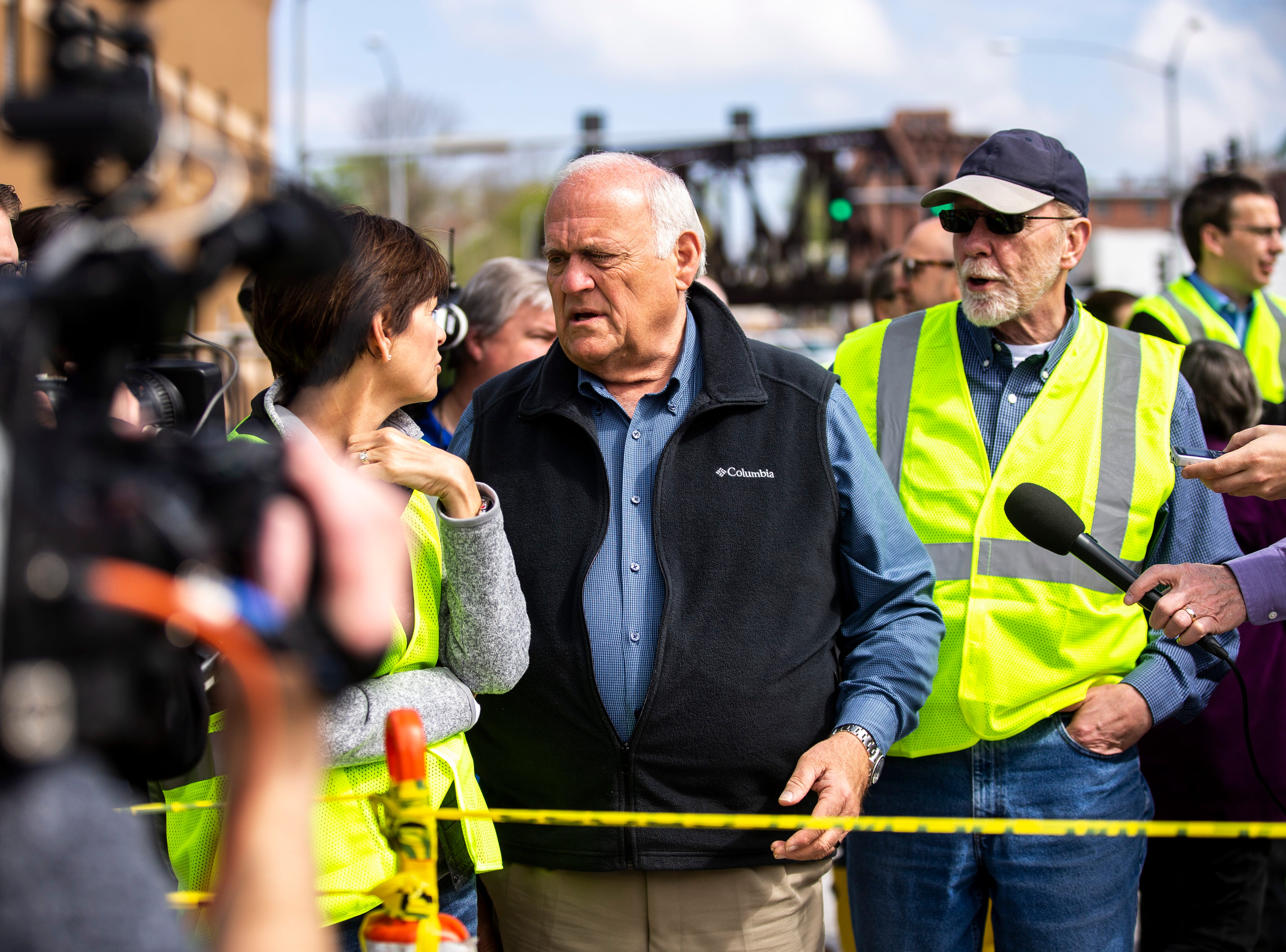 Davenport Mayor Frank Klipsch, center, talks with Iowa Gov. Kim Reynolds, while touring areas impacted by floodwater, with U.S. Rep. Dave Loebsack, D-Iowa, (right) Friday, May 3, 2019, in downtown Davenport, Iowa. The temporary flood barrier at Pershing Avenue and River Drive failed Tuesday afternoon.