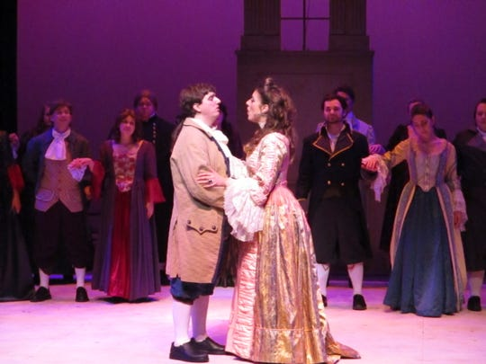 "The character of Percy Blakeney and Marguerite St. Just embrace during their wedding in the first act of ""The scarlet Pimpernel."""