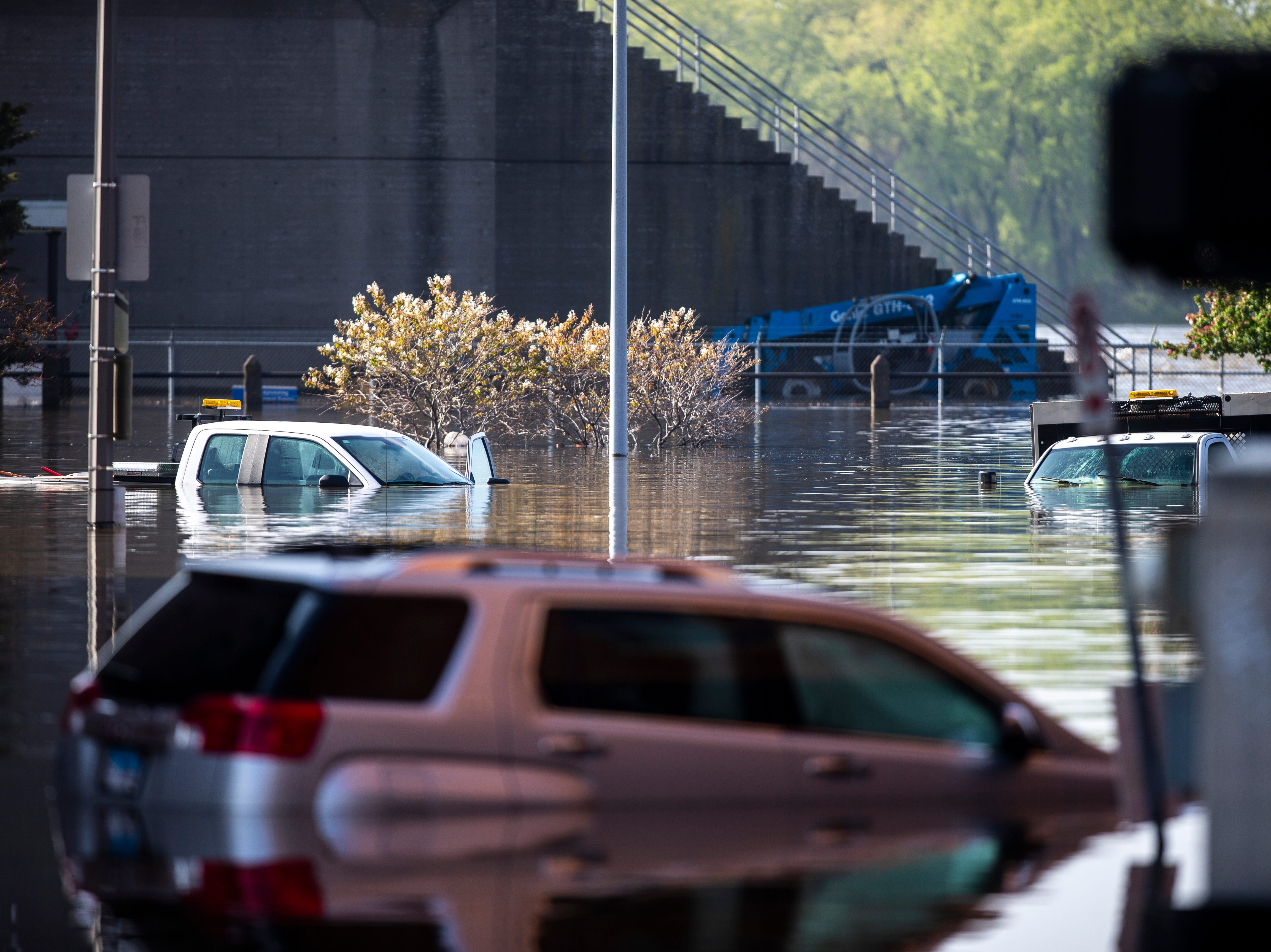 Vehicles remain underwater along River Street and Pershing Avenue, Friday, May 3, 2019, in downtown Davenport, Iowa.