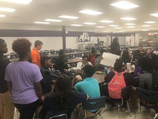 About 50 students sit in protest after a noose was found hanging in the automotive class room Wednesday afternoon at Milan High School.