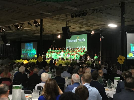 Emerald Youth Choir sings Friday morning at the nonprofit's annual Prayer Breakfast. This year's announcements included plans for a health clinic in Lonsdale.