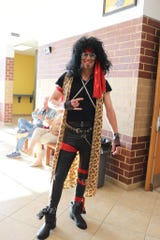 Chris Craighead channels his inner 1980s hair band rock icon at the annual Adult Social sponsored by All Saints Catholic Church.