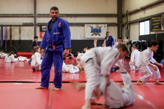 Carlos Soto watches as he teaches a kids self-defense class, Thursday, May 2, 2019 at Impact Zone Training Center in West Lafayette.