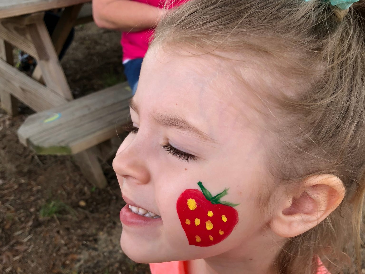 Avery Guidry has a strawberry painted on her face April 6 at Mrs. Heather's Strawberry Farm in Albany, Louisiana.