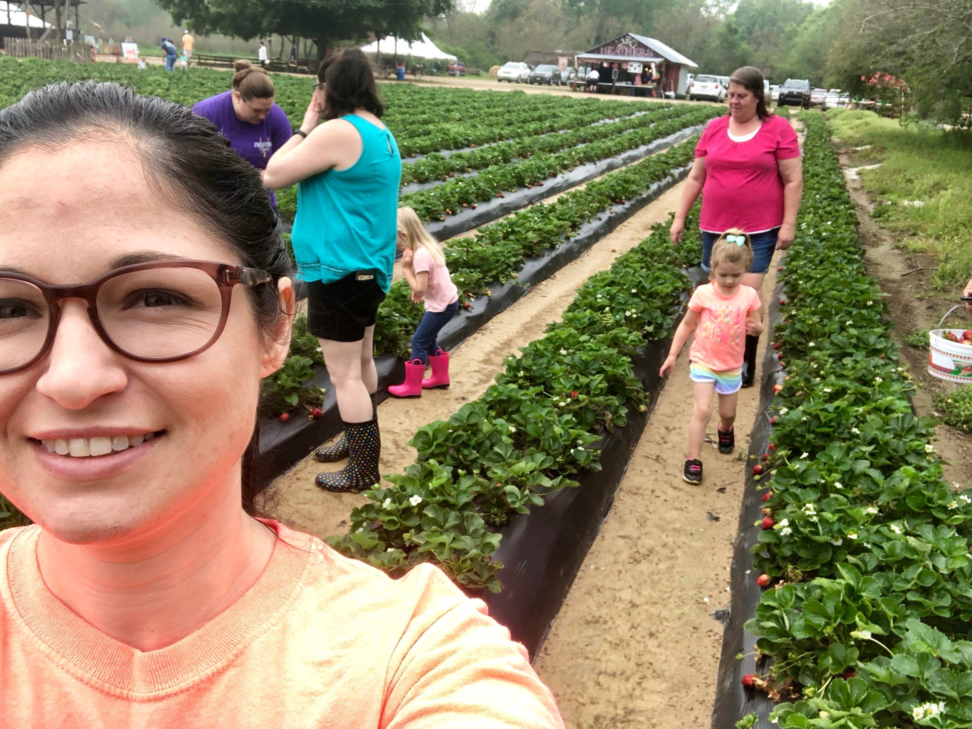 Reporter Leigh Guidry snaps a selfie while her family picks strawberries April 6.