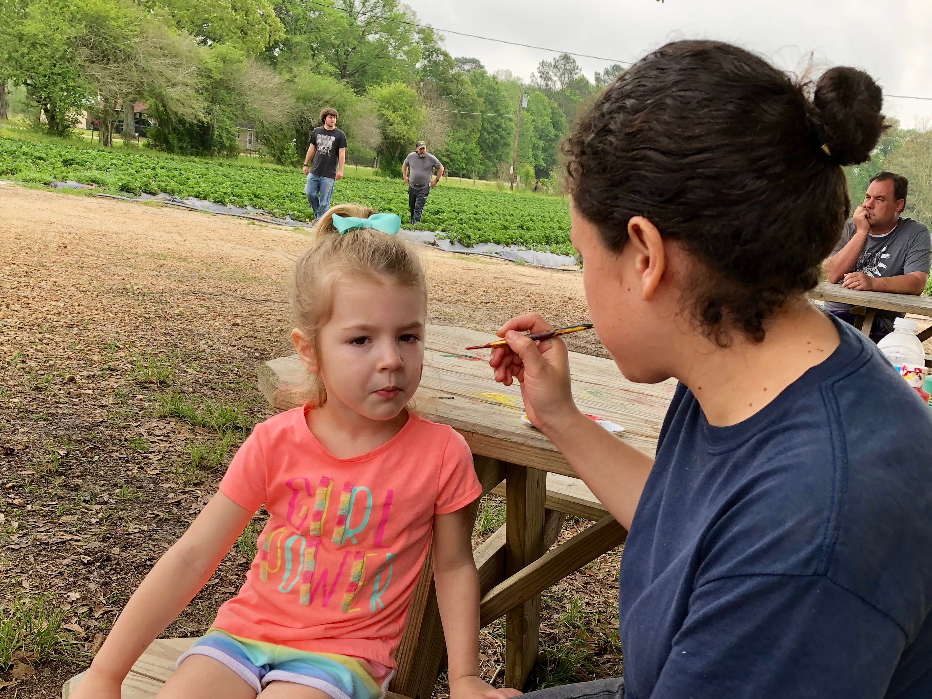 Avery Guidry gets a strawberry painted on her face April 6 at Mrs. Heather's Strawberry Farm in Albany, Louisiana.
