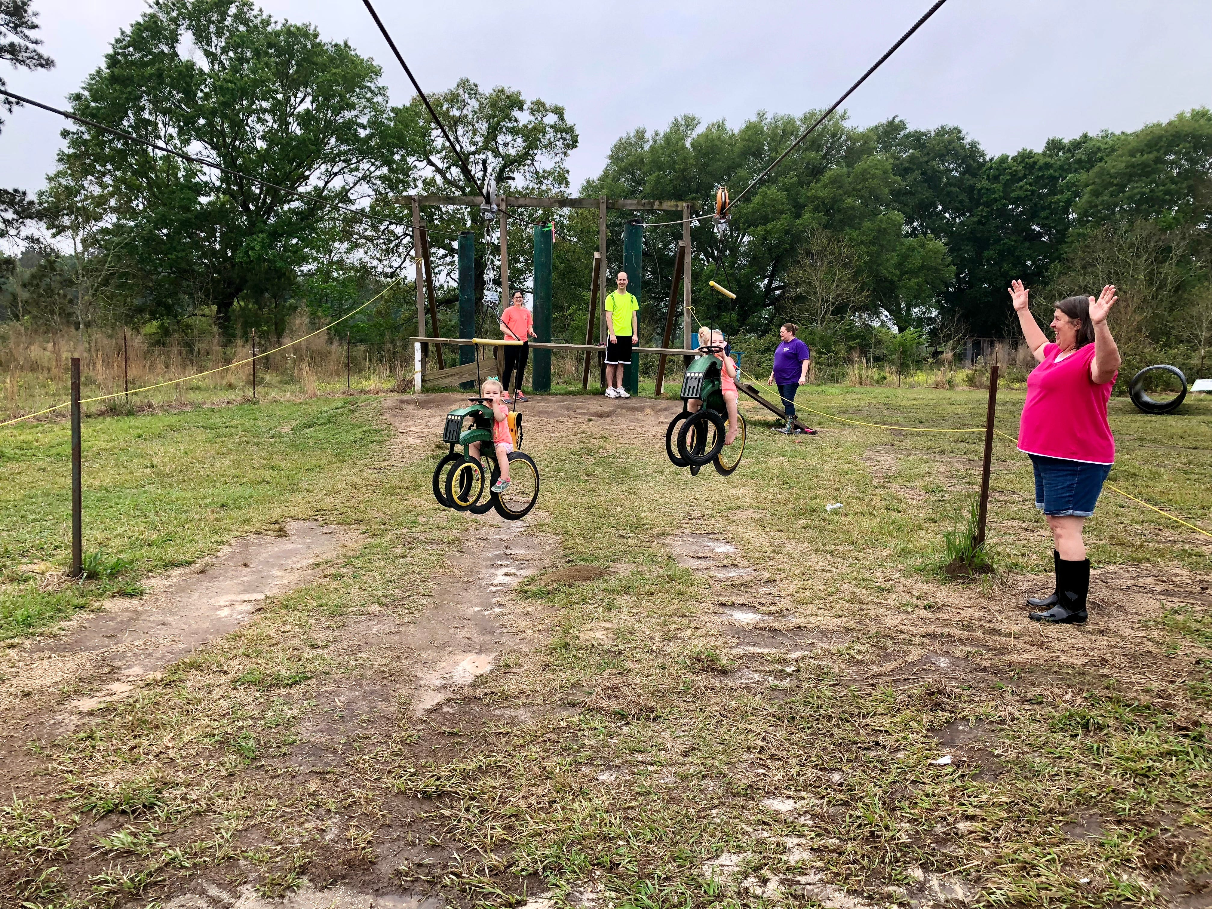 Visitors can pick fruit and zipline on tires in the shape of John Deer tractors at Mrs. Heather's Strawberry Farm in Albany, Louisiana.