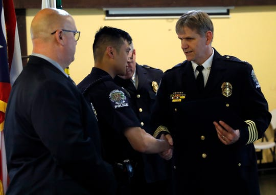 Lancaster Police Chief Adam Pillar, right, shakes hands with Officer Andrew Hoyt as he presents Hoyt and Det. Ernie King with the Randy Bartow Distinguished Service Award. Hoyt and King earned the award for their response to the fatal shooting of Corena Bower at Casa Grande Motel in February 2018. Hoyt and King were recognized during the department's annual awards ceremony Friday, May 3, 2019, at the Fraternal Order of Police Lodge in Lancaster.