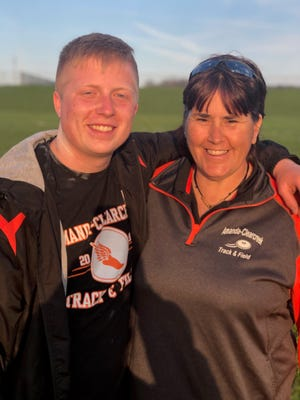 Amanda-Clearcreek senior Noah Smith stands with his track and field coach, Denise (Hooker) Morgan. They both hold school records in the shot put and discus.