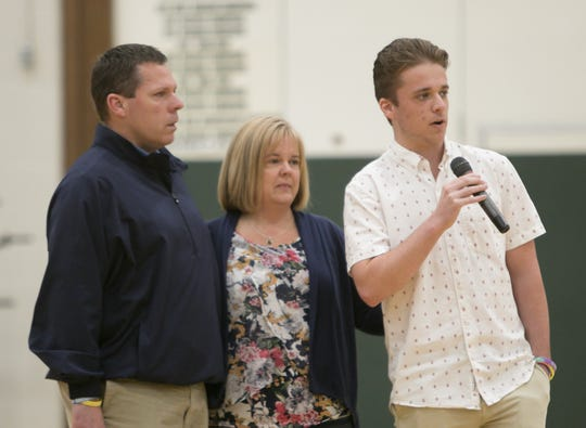 From left, Mark Ward, Beth Brown, with their son Stephen Ward-Brown, voice their appreciation for money raised for Julianna's Wishes, a charity in memory of their daughter Julianna Ward-Brown. The funds were raised by Howell High School students in their annual Senior Survivor event, culminating with the assembly Friday, May 3, 2019. Ward-Brown died in a car crash last year.