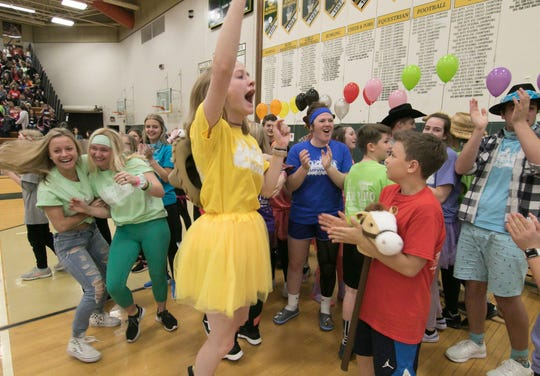 Students celebrated at the Howell High School Senior Survivor assembly Friday, May 3, 2019 after hearing that the amount raised, over $135,000, broke records over previous years.