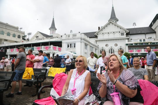 Monique O' Daniel, right, and friend Linda Braden cheer during race 2 at the 2019 Kentucky Oaks on Friday, May 3, 2019, at Churchill Downs in Louisville, Kentucky.