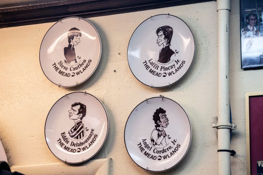 Commemorative plates adorn the walls of Wagner's Pharmacy celebrating the history of past jockeys. May 3, 2019