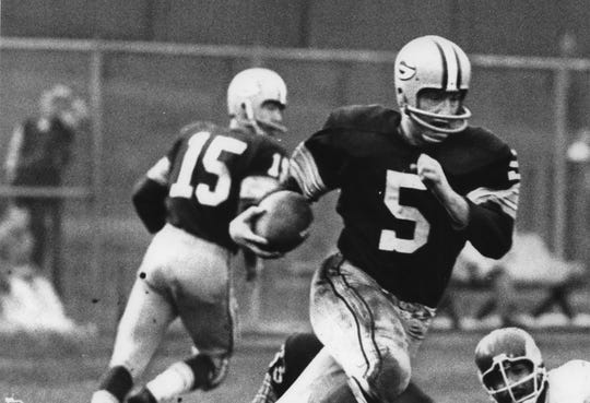 Showing classic form of the cutback Paul Hornung of the Packers gained four yards over right tackle in the third quarter of their game with the Vikings at County Stadium Sunday.