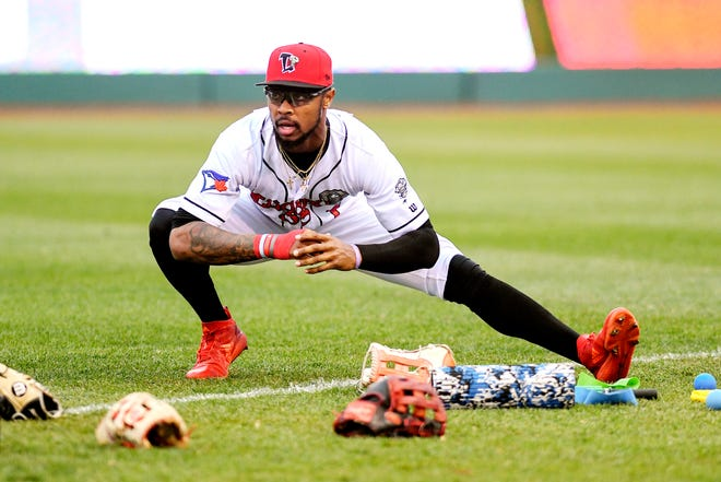 Lugnuts right fielder DJ Neal stretches before the start of Lansing's game against the Wisconsin Timber Rattlers on Thursday, May 2, 2019, at Cooley Law School Stadium in Lansing.