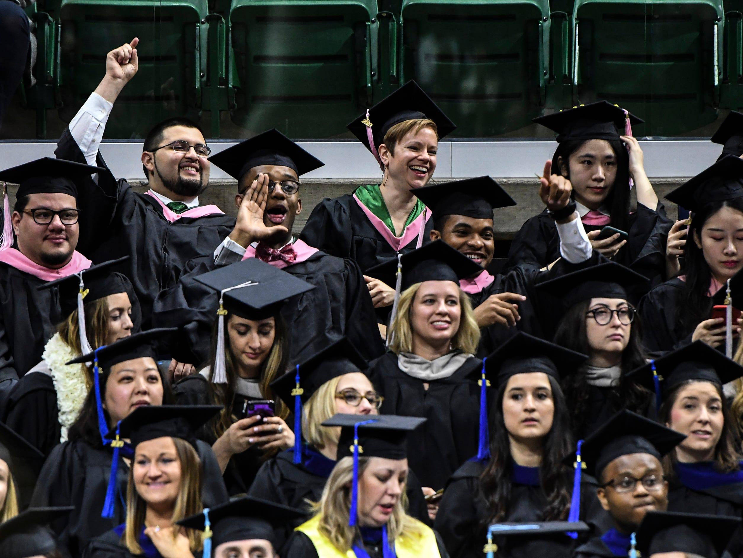 Michigan State University graduates cheer Friday, May 3, 2019, during the 2019 commencement at the Breslin Center in East Lansing.