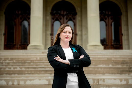 Michigan State University alum Hannah Smith, photographed on Thursday, May 2, 2019, outside the Michigan State Capitol in Lansing, has filed a federal complaint about how the school handled her Title IX case. Smith is still waiting on a final report in the claim she filed more than a year ago against a professor who started talking to her after class and made inappropriate comments.
