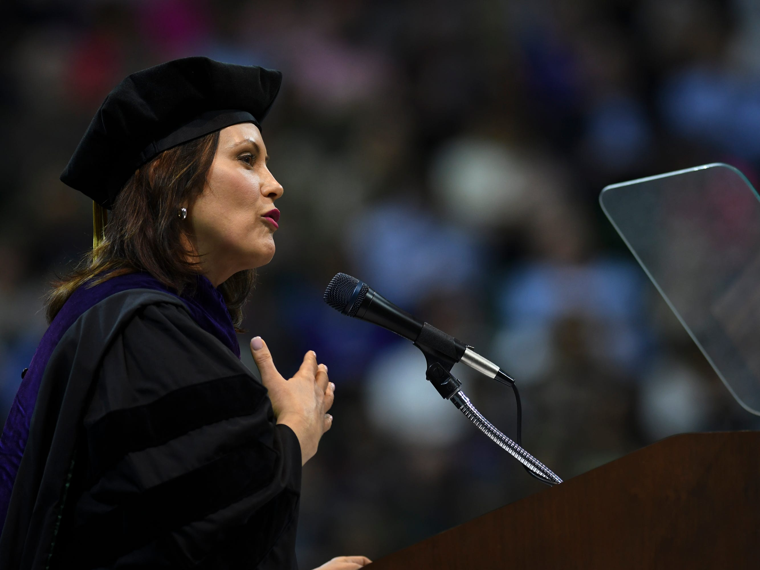 """After Michigan Gov. Gretchen Whitmer joked about not mentioning her campaign slogan on fixing roads, she gave these four pieces of advice to Michigan State University graduates Friday, May 3, 2019, at the Breslin Center:  """"Build bridges - don't live under them, look for inspiration in unusual places, wear fun socks and do not read the comments section."""" Whitmer has a bachelor's degree in communications from MSU.  She was awarded an honor degree of Doctor of Laws Friday afternoon."""