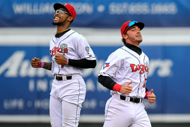 Lugnuts right fielder DJ Neal, left, jokes with teammate  Hagen Danner before the start of Lansing's game against the Wisconsin Timber Rattlers on Thursday, May 2, 2019, at Cooley Law School Stadium in Lansing.