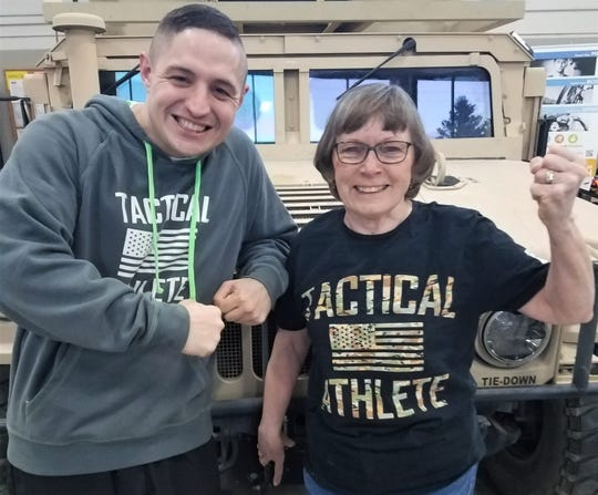 Joyce Morrison – hesitant to join the Lean on the Lakeshore challenge at the age of 73 – not sure she could do any of the workouts. Pictured with National Guard Boot Camp leader Sgt. Robert Rocheleau.