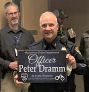 Manitowoc police officer Peter Dramm was honored for his 32 years of service upon his retirement.