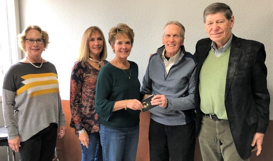 Helen Gajdys Reis & Lester Reis Endowment Fund board members present a check to Woody Shulander of Peter's Pantry. Pictured, from left: Mary Reis, Kathy Hanke, Gloria Theis, Shulander and George Reis.