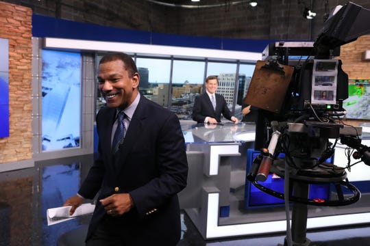 WMC's Jarvis Greer walks off the set after his segment for the evening news Thursday.