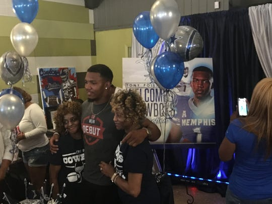 Tony Pollard celebrates with his family at his autograph signing at Pollards' BBQ. The former Memphis standout was drafted by the Dallas Cowboys in the fourth round during the 2019 NFL Draft.