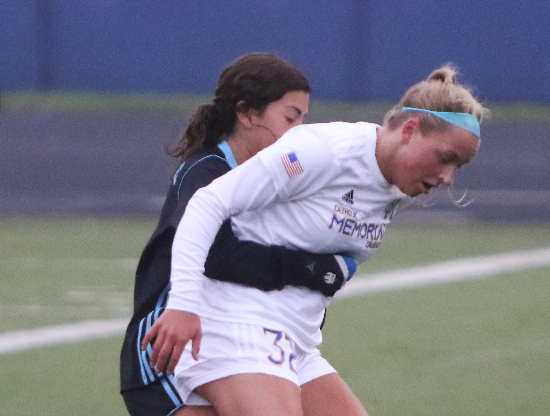 Catholic Memorial forward Abby Piette (right) is fouled by Brookfield Central defender Ryann Locante during a game on May 2, 2019.