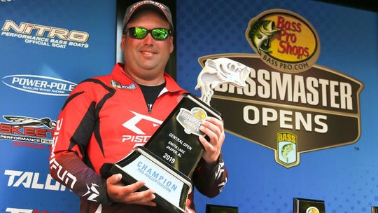 Caleb Kuphall of Mukwonago poses for a photo with the first-place trophy after winning the 2019 Bassmaster Central Open on Smith Lake in Jasper, Alabama. The event was held April 25-27. Kuphall earned $37,200 for the win.