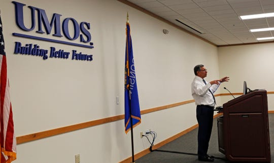 UMOS president and CEO Lupe Martinez addresses his staff. UMOS at 2701 S. Chase Ave. will be open Monday and Tuesday when the Milwaukee Job Center at 4201 N. 27th St. is closed.