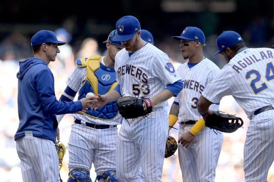 Brewers manager Craig Counsell relieves starting pitcher Brandon Woodruff during a game against the Dodgers on April 21.  The Brewers knew it was a gamble going with three young starters in Woodruff, Corbin Burnes and Freddy Peralta at the same time to begin the season, but decided to take the risk.