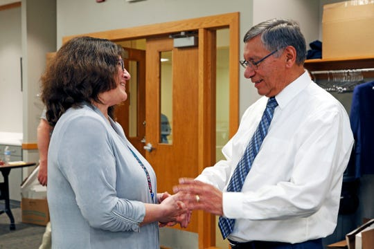 "Heidi Rattner, left, shares a moment with UMOS President and CEO Lupe Martinez following a program to recognize his 50 years of service to UMOS. ""He inspired me to go into social justice work,"" Rattner said."