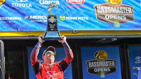 Caleb Kuphall of Mukwonago holds the trophy after winning the 2019 Bassmaster Central Open fishing tournament at Smith Lake in Jasper, Alabama. The event was held April 25-27, 2019.