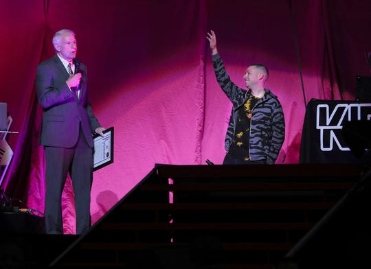 Milwaukee Mayor Tom Barrett, left, presents an offical City of Milwaukee Proclamation declaring it Kid Cut Up Day in Milwaukee. DJ Kid Cut Up, right, performed before the Pink concert at Fiserv Forum.