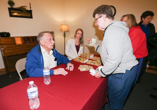 "Former Wisconsin governor Marty Schreiber signs copies of his book,  ""My Two Elaines."" Scheiber has been caring for his wife who suffers from Alzheimers disease."