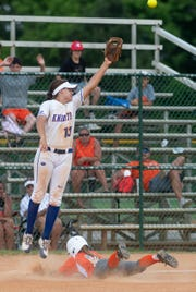 Macon East's Madisyn Kennedy leaps for the overthrown ball as Glenwood' Chloe Enfinger is safe at third in the AISA State Softball Tournament at Lagoon Park in Montgomery, Ala., on Friday May 3, 2019. Enfinger scoured on the play winning the state championship for Glenwood.